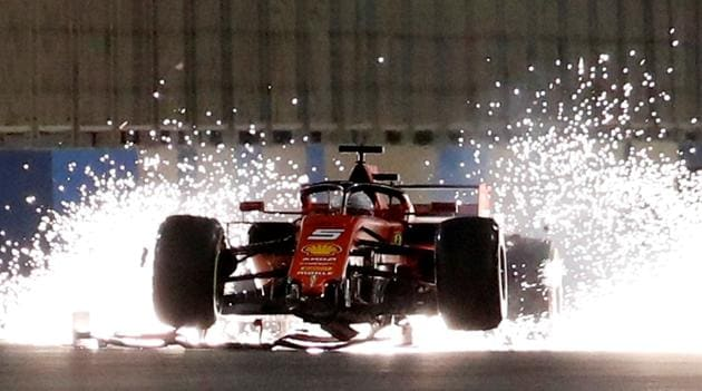 Ferrari's Sebastian Vettel with a damaged car during the Formula One F1 Bahrain Grand Prix at Bahrain International Circuit, Sakhir, Bahrain.(REUTERS)