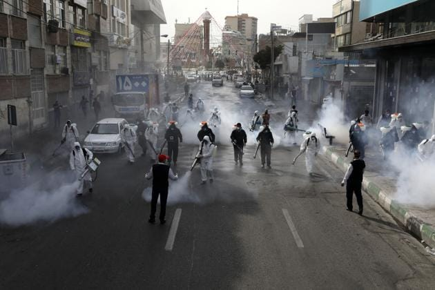 Firefighters disinfect a street against the new coronavirus, in western Tehran, Iran, Friday, March 13, 2020.(AP photo)