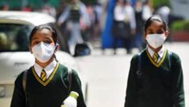 School students wearing protective masks as a precautionary measure against coronavirus, as they exit after a CBSE Board Examination, New Delhi, March 13, 2020(Amal KS/HT PHOTO)