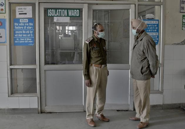 Ludhiana, India – March 15, 2020: Police outside the isolation ward at civil hospital in Ludhiana on Sunday, March 15, 2020. (Photo by Harsimar Pal Singh/Hindustan Times)