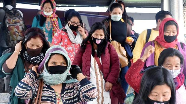 Passenger wearing protective mask in the wake of novel coronavirus, at Guwahati Railway Station last week.(ANI Photo)
