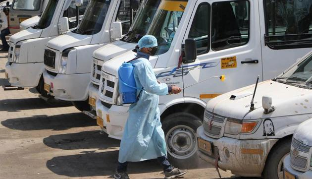 Municipal Corporation worker sprays disinfectant at a bus stand, as a precautionary measure against coronavirus (COVID-19), in Jammu, Wednesday, March 18, 2020.(PTI photo)