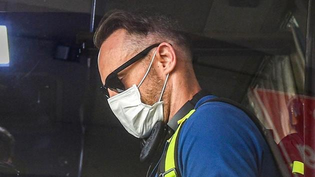 South Africa player Faf du Plessis wear a mask as a preventive measure against coronavirus, during his arrival with teammates, at NSCBI Aiport, in Kolkata, Monday, March 16, 2020.(PTI)