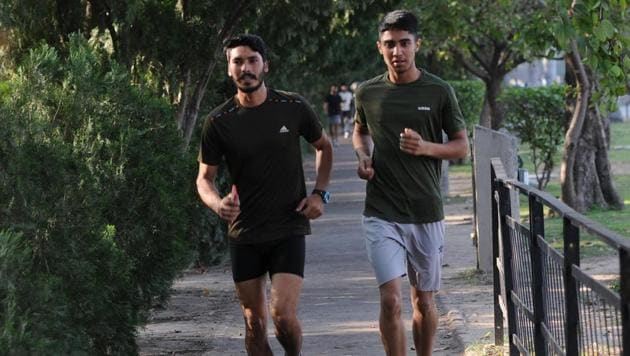 Joggers at Sukhna Lake in Chandigarh on Thursday.