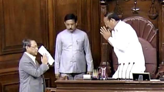 Rajya Sabha Chairman M Venkaiah Naidu greets former Chief Justice of India Ranjan Gogoi after he took oath as Rajya Sabha MP on Thursday.(ANI Photo)