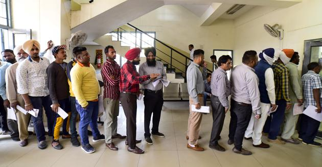 Residents standing in a queue at an auto-driving test centre in Ludhiana.(Gurpreet Singh/HT)