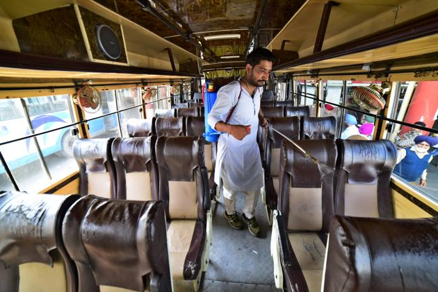 A worker sanitising a bus at the ISBT in Ludhiana on Thursday.(Gurpreet Singh/HT)
