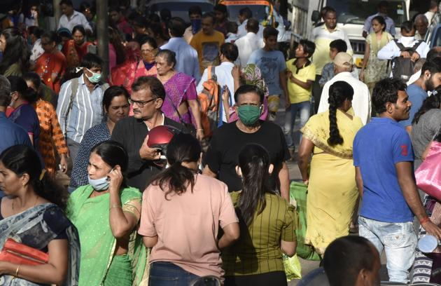 Covid-19: A man wear a mask due to coronavirus spread at crowded Dahisar Market in Mumbai.(Pramod Thakur/ Hindustan Times)
