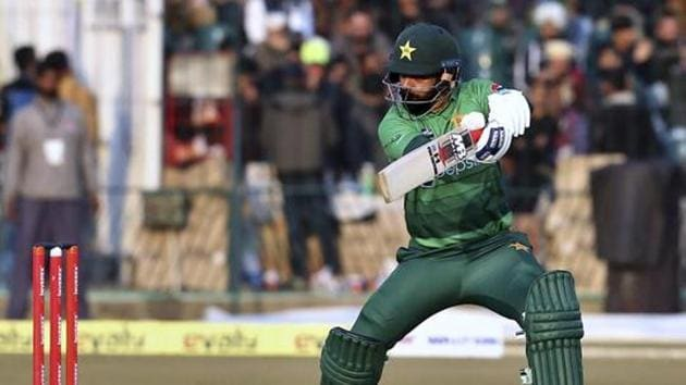 Pakistan batsman Mohammad Hafeez follows the ball after playing a shot during the second T20 cricket match against Bangladesh at Gaddafi stadium, in Lahore, Pakistan.(AP)