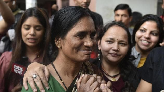 New Delhi, India - March 20, 2020: Asha Devi, mother of the 2012 Delhi gang rape victim celebrates with her neighbours after the four convicts were hanged today, at Dwarka, in New Delhi, India, on Friday, March 20, 2020. (Photo by Vipin Kumar / Hindustan Times)(Vipin Kumar/HT PHOTO)