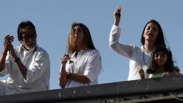 Amitabh Bachchan, Aishwarya Rai Bachchan, Aaradhya and Abhishekh Bachchan clap and ring bells. (Photo by Pramod Thakur/ Hindustan Times)