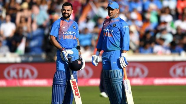 MS Dhoni and Virat Kohli in action.(Getty Images)