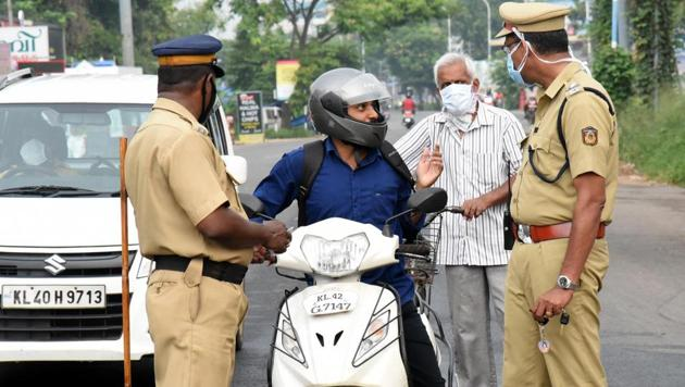 Police personnel stop a commuter amid nationwide lockdown to control the spread of COVID-19 Novel Coronavirus, in Kochi on Wednesday.(ANI photo for representation)