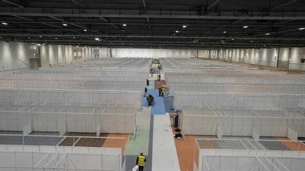 In this photo taken on March 27, 2020, work in progress to turn the ExCel centre into a temporary hospital - the NHS Nightingale hospital, in London. The makeshift hospital will comprise of two wards with the capacity to hold 2,000 people in each.(AP)