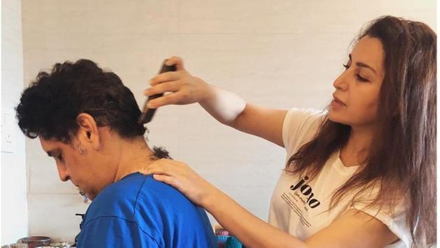 Tisca Chopra turns hairstylist for her husband Sanjay Chopra.