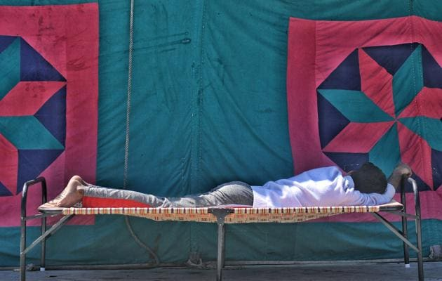 File photo of a man resting outside a relief camp at Mustafabad, near Eidgah Masjid, in New Delhi.(Biplov Bhuyan / HT File Photo)