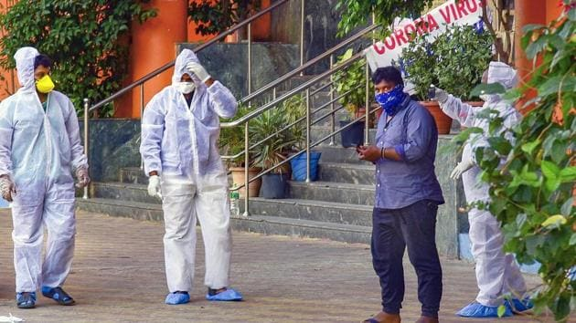 Medical staff members wear masks and protective suits to mitigate the spread of coronavirus outside the special isolation ward at Gandhi Hospital in Hyderabad.(PTI File Photo)