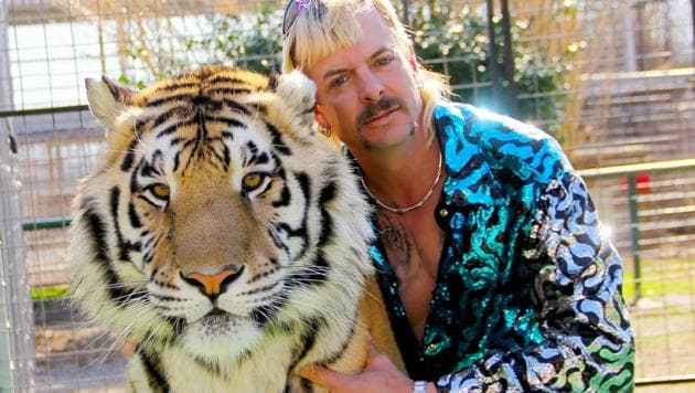 Tiger King review: Joe Exotic poses with one of his big cats.(Courtesy of NETFLIX)