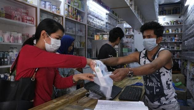 A woman buys surgical masks in Imphal, Manipur, March 20, 2020. The state reported its first Covid-19 case on March 24.(AP File)