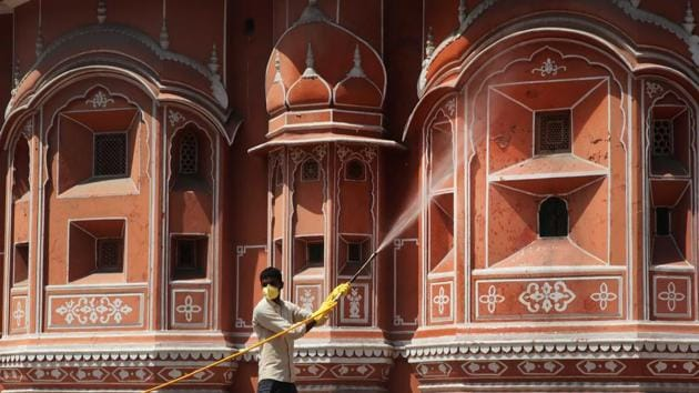Health workers sanitize and disinfect the area near Hawa Mahal on day six of the 21 day nationwide lockdown in Jaipur. (Himanshu Vyas / HT Photo)