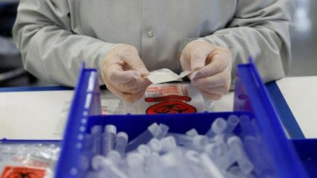 A technician assembles coronavirus test kits at Evolve manufacturing facility, where they will be manufacturing ventilators, in Fremont, California, US March 26, 2020.(Reuters File Photo)