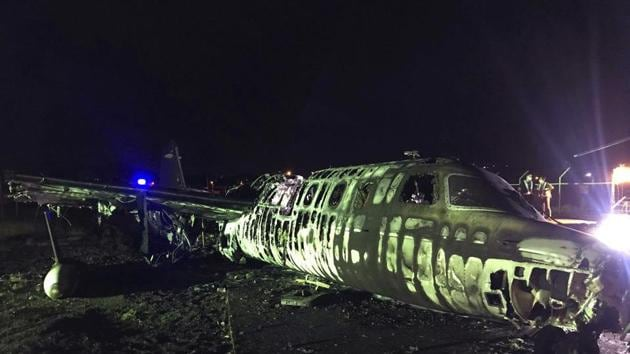 In this handout photo provided by the Manila International Airport Authority (MIAA) Media Affairs Office, the remains of a Lion Air, West Wind 24 aircraft lies along the runway after it caught fire during take off at Manila's International Airport in Philippines late Sunday March 29, 2020.(AP)
