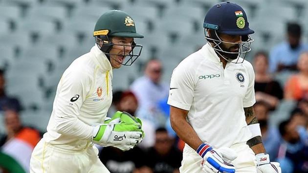 Australia's captain Tim Paine (L) celebrates as India's captain Virat Kohli leaves the field after being dismissed.(REUTERS)
