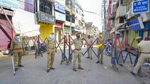 Police personnel during a search operation for devotees who had attended religious congregation at Tabligh-e-Jamaat's Markaz in Delhi's Nizamuddin area, in Prayagraj on April 1.(PTI Photo)