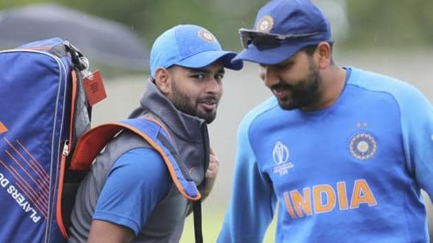 India's Rishabh Pant, left, talks to teammate Rohit Sharma during a training session.(AP)