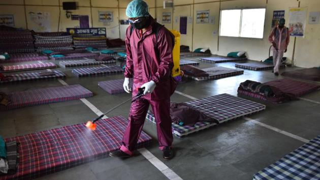 Workers from an NGO spray disinfectant during the sanitization of a night shelter in Delhi on day 9 of the 21-day nationwide lockdown to check the spread of coronavirus.(Sanchit Khanna/HT PHOTO)