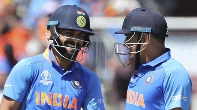 India's captain Virat Kohli, left, and batting partner MS Dhoni(AP)