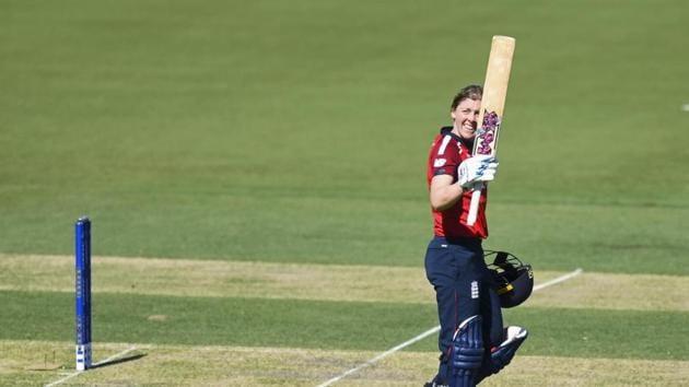 Heather Knight of England raises her bat.(AP)