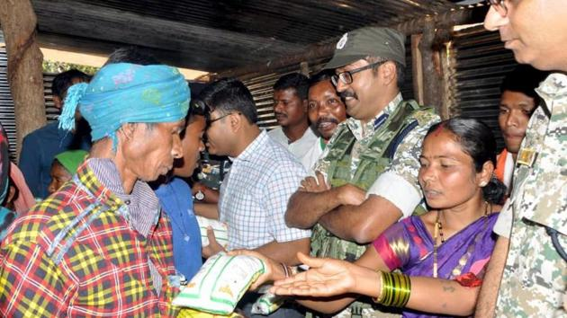 Security officials distributing ration at Bodli village of Bastar district, Chhattisgarh on Monday.(ANI)