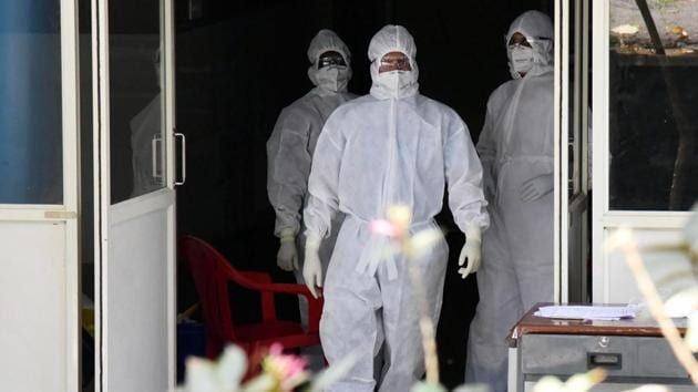 Medical officers wearing protective suits outside the Special Isolation Ward of Coronavirus patients at Aluva government general hospital in Kochi.(ANI)