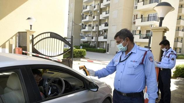 Gurugram, India- April 02, 2020: A resident of Mapsko Casabella undergoes thermal screening on day nine of the 21-day nationwide lockdown to check the spread of coronavirus, at Sector-82, near Kherki Daula toll plaza, in Gurugram, India, on Thursday, April 02, 2020. (Photo by Parveen Kumar/Hindustan Times)