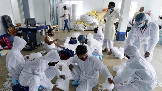 Workers manufacturing Personal protective equipment (PPE) suits for the medical staff in Kolkata.(ANI Photo)