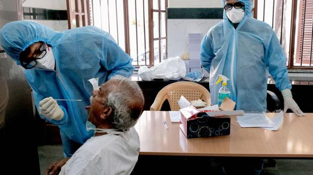Medics collect swab from a person for COVID-19 test as part of a drive to control the spread of the new coronavirus, in Madanpura area Mumbai, Tuesday, April 7, 2020.(PTI)