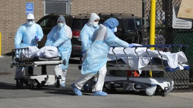 Healthcare workers wheel the bodies of deceased people outside the Wyckoff Heights Medical Center during the outbreak of the coronavirus disease in the Brooklyn borough of New York City.(Reuters File Photo)
