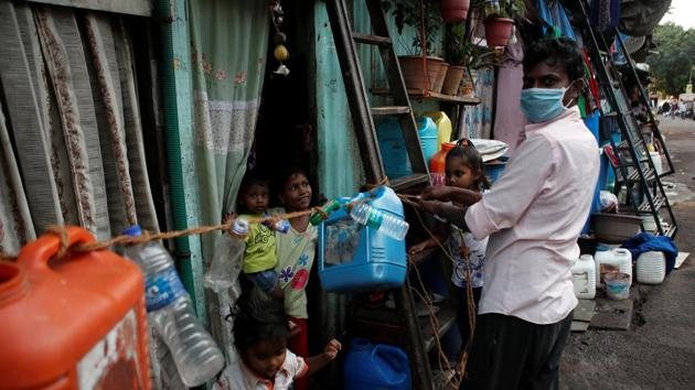 A man ties a rope outside his house to prevent his children from going outside and to stop people from coming to his home, after people in the area tested positive for the coronavirus disease Covid-19 in Dharavi, Mumbai, on April 6.(Reuters Photo)