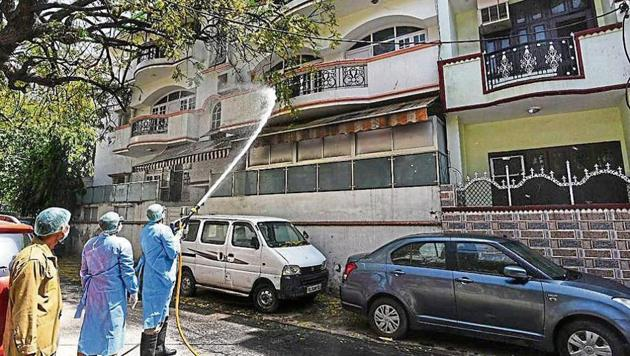 Covid-19 update: Fire service personnel spray disinfectant, on day fourteen of the 21 day nationwide lockdown to check the spread of coronavirus, during sanitization of the residential area adjoining Nizamuddin Dargah in New Delhi.(Photo: Vipin Kumar/ Hindustan Times)
