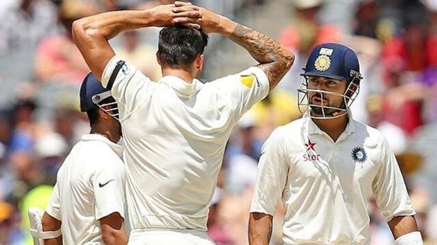 File photo of Virat Kohli and Mitchell Johnson.(Reuters)