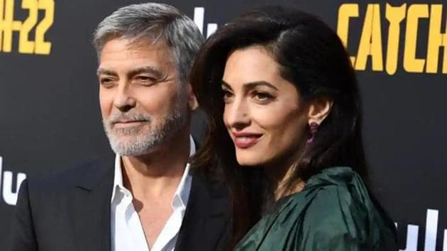 George Clooney poses with wife Amal at the premiere of his show Catch-22.