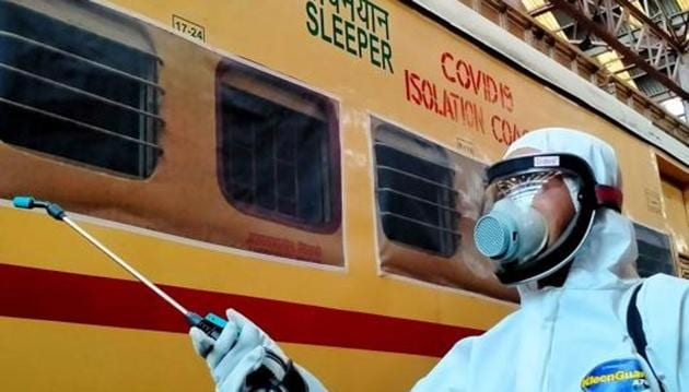 A Railway worker spraying disinfectant on a Covid-19 isolation coach during a nationwide lockdown as a preventive measure against the coronavirus.(ANI PHOTO.)