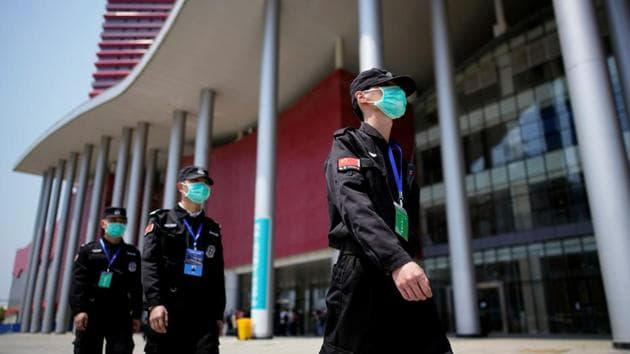 Security personnel patrol outside a convention center that was used as a makeshift hospital to treat patients with the coronavirus disease (COVID-19), in Wuhan, Hubei province, China April 9, 2020.(REUTERS)