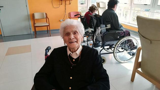 """In this photo taken on April 6, 2020, 103-year-old Ada Zanussi, poses for pictures at the nursing home """"Maria Grazia"""" in Lessona, northern Italy, after recovering from Covid-19 infection. To recover from coronavirus infection, as she did, Zanusso recommends courage and faith, the same qualities that have served her well in her nearly 104 years on Earth. The new coronavirus causes mild or moderate symptoms for most people, but for some, especially older adults and people with existing health problems, it can cause more severe illness or death. (Residenza Maria Grazia Lessona via AP Photo)(AP)"""