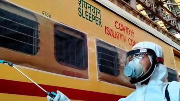 Railway worker sprays disinfectant on COVID19 isolation coach during a government-imposed nationwide lockdown as a preventive measure against the COVID-19 coronavirus, in Kolkata on Wednesday.(ANI)