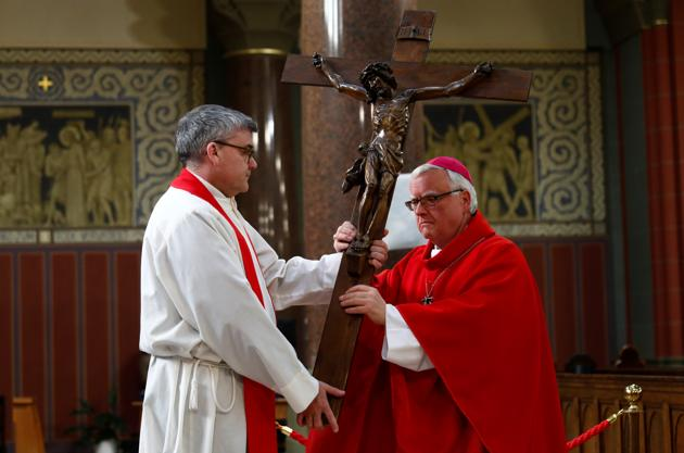 A priest rehearses celebrations of Good Friday liturgy at a church in Berlin, Germany, on April 9.(Reuters Photo)