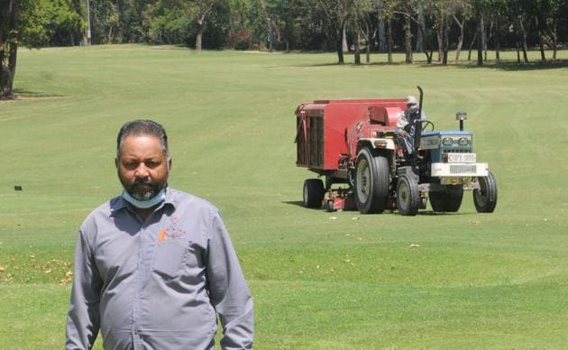 Assistant course manager Surjit Singh along with his team maintaining the course of the Chandigarh Golf Club on Saturday.