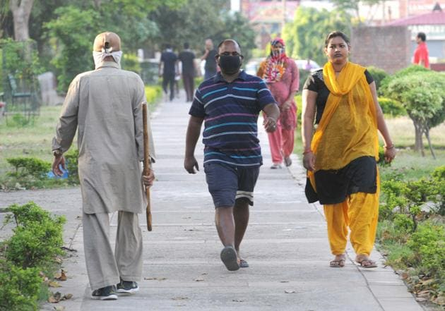 Residents out for a morning walk in Sector 45, Chandigarh, on Saturday, despite the curfew in the city.(KESHAV SINGH/HT)