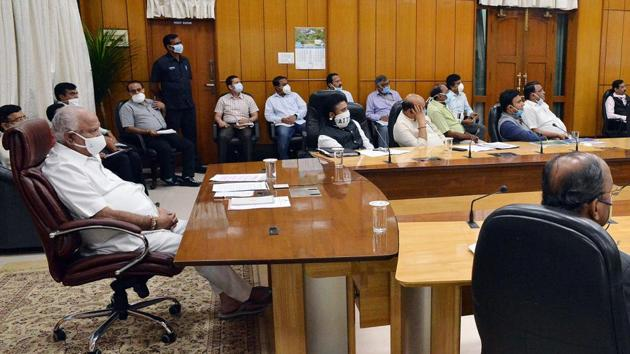 Karnataka Chief Minister B S Yediyurappa with officials in a video conference with Prime Minister Narendra Modi at Vidhana Soudha in Bengaluru on Saturday.(ANI Photo)